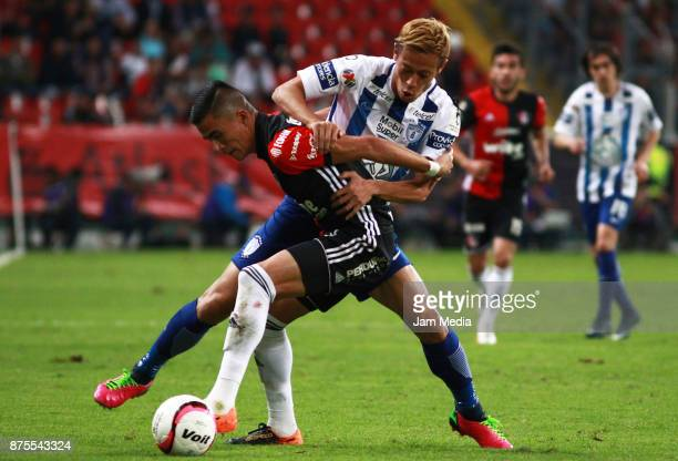 Luis Reyes of Atlas and Keisuke Honda of Pachuca fight for the ball during the 17th round match between Atlas and Pachuca as part of the Torneo...