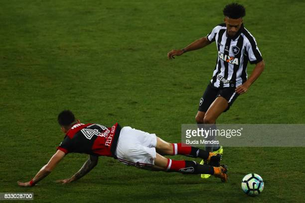 Luis Ricardo of Botafogo struggles for the ball with of Flamengo during a match between Botafogo and Flamengo as part of Copa do Brasil Semifinals...