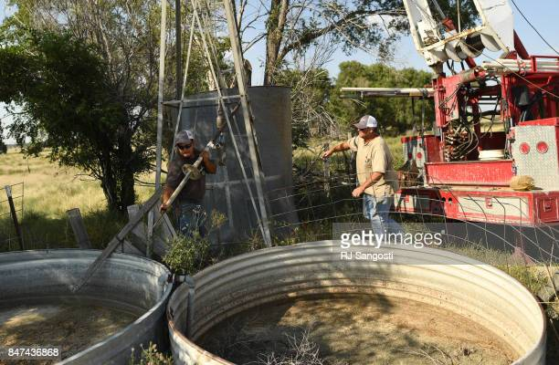 Luis Rico left and Jim Henson both employees of New Banks Pumps work on trying to fix a well on September 12 2017 in Wray Colorado The two were able...