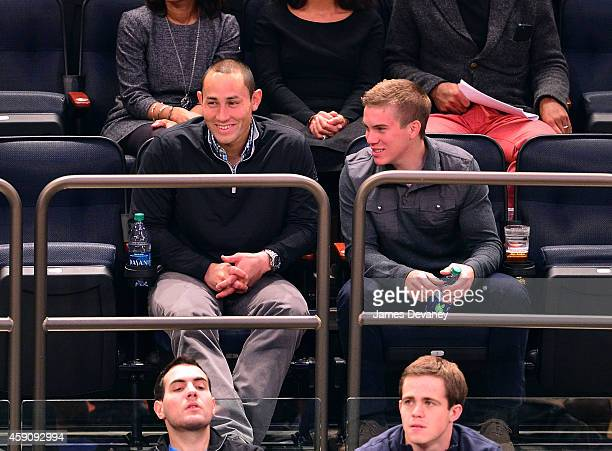 Luis Robles and guest attends the Denver Nuggets vs New York Knicks game on November 16 2014 in New York City