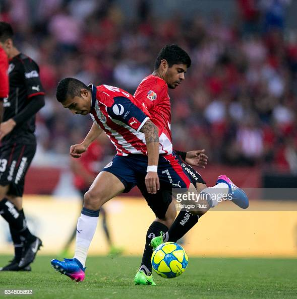 Luis Robles of Atlas fights for the ball with Orbelin Pineda of Chivas during the 6th round match between Atlas and Chivas as part of the Torneo...