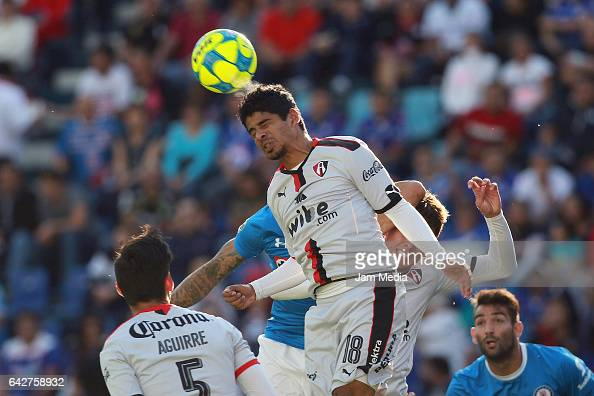 Luis Robles of Atlas heads the ball during a match between Cruz Azul against Atlas the Clausura Tournament 2017 league Bancomer MX at Azul Stadium on...