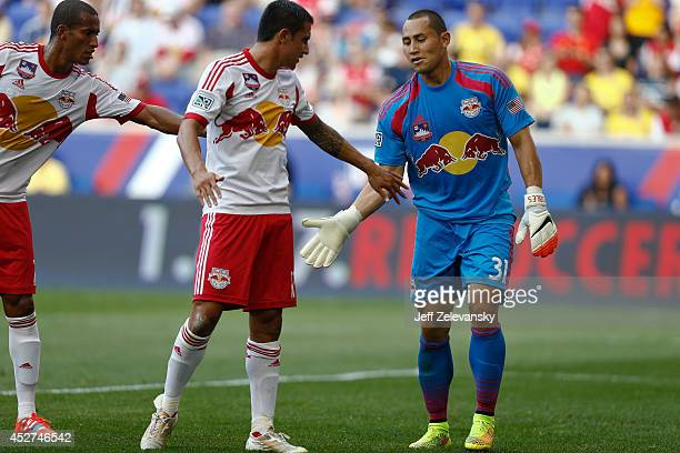 Luis Robles of New York Red Bulls greets Tim Cahill of New York Red Bulls during their friendly match at Red Bull Arena on July 26 2014 in Harrison NJ