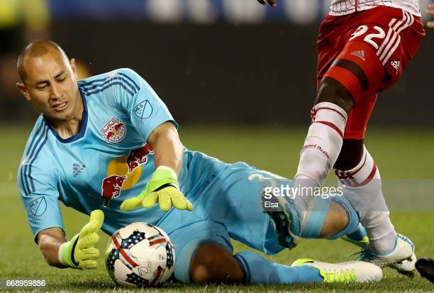 Luis Robles of New York Red Bulls stops a shot in the second half against the DC United at Red Bull Arena on April 15 2017 in Harrison New Jersey