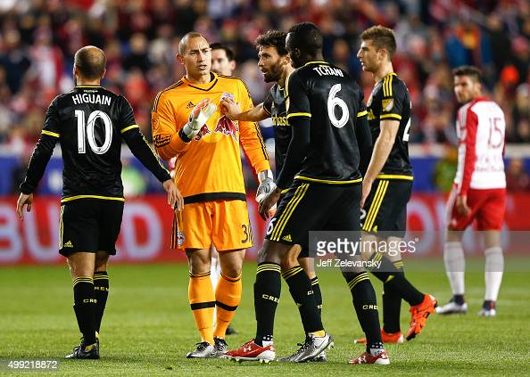 Luis Robles of New York Red Bulls talks with members of the Columbus Crew during their match at Red Bull Arena on November 29 2015 in Harrison New...
