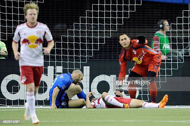 Luis Robles of the New York RedBulls calls for help from the bench for fallen teammate Kosuke Kimura during the MLS game against the Montreal Impact...