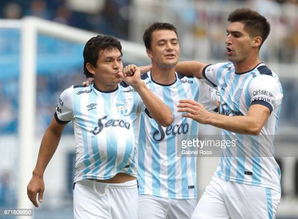 Luis Rodriguez of Atletico de Tucuman celebrates with teammates after scoring the penalty goal for his team during a match between Racing and...