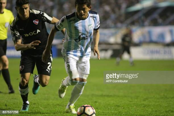 Luis Rodriguez of Atletico Tucuman disputes the ball with Alan Franco of Independiente in their Copa Sudamericana 2017 football match at the Jose...