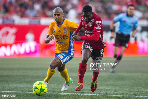 Luis Rodriguez of Tigres and Aviles Hurtado of Xolos fight for the ball during the semi final second leg match between Tijuana and Tigres UANL as...