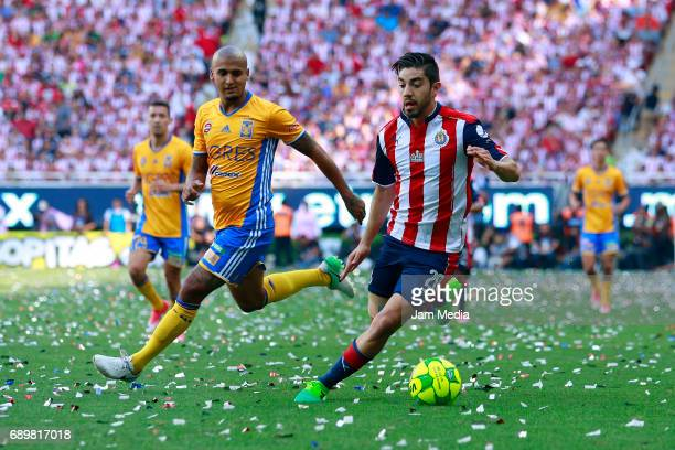 Luis Rodriguez of Tigres fights for the ball with Rodolfo Pizarro of Chivas during the Final second leg match between Chivas and Tigres UANL as part...