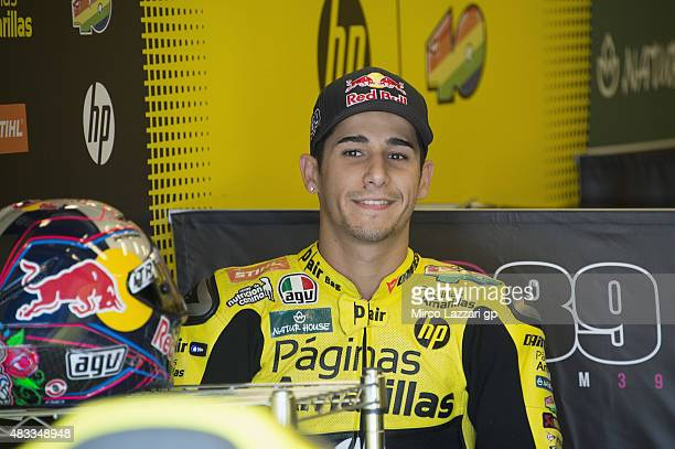Luis Salom of Spain and Pagina Amarillas HP40 smiles in box during the MotoGp Red Bull US Indianapolis Grand Prix Free Practice at Indianapolis Motor...