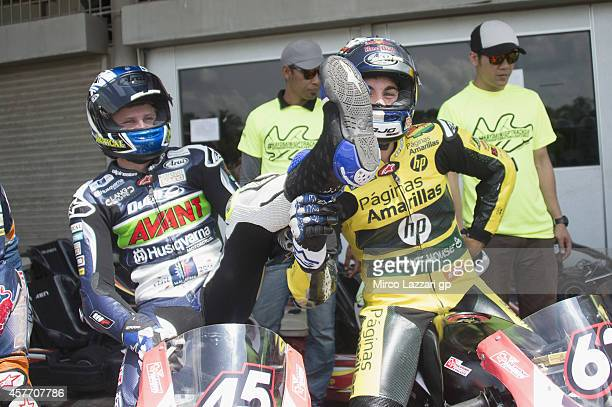 Luis Salom of Spain and Pons HP40 jokes with Niklas Ajo of Finland and Avant Techno Husquarna Ajo during the preevent 'MotoGP riders the Mini Bikes...
