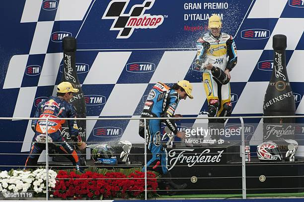 Luis Salom of Spain and Red Bull KTM Ajo Alex Rins of Spain and Estrella Galicia 0'0 and Maverick Vinales of Spain and Team Calvo celebrate on the...