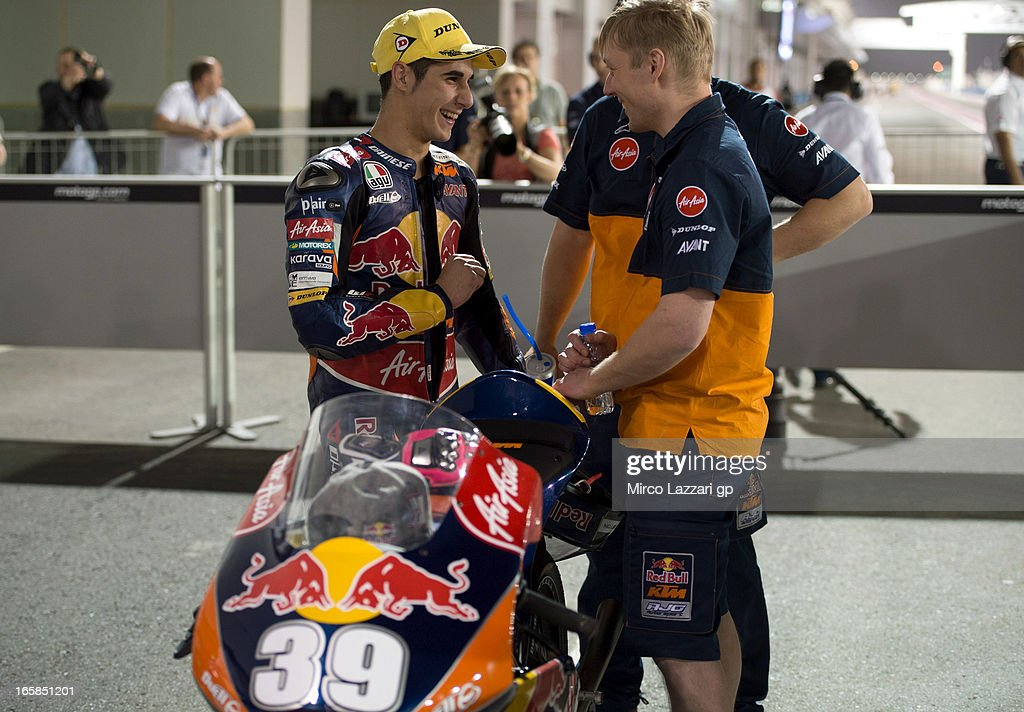 Luis Salom of Spain and Red Bull KTM Ajo speaks with his mechanics and celebrates the Pole Position at the end of the MotoGp of Qatar - Qualifying at Losail Circuit on April 6, 2013 in Doha, Qatar.