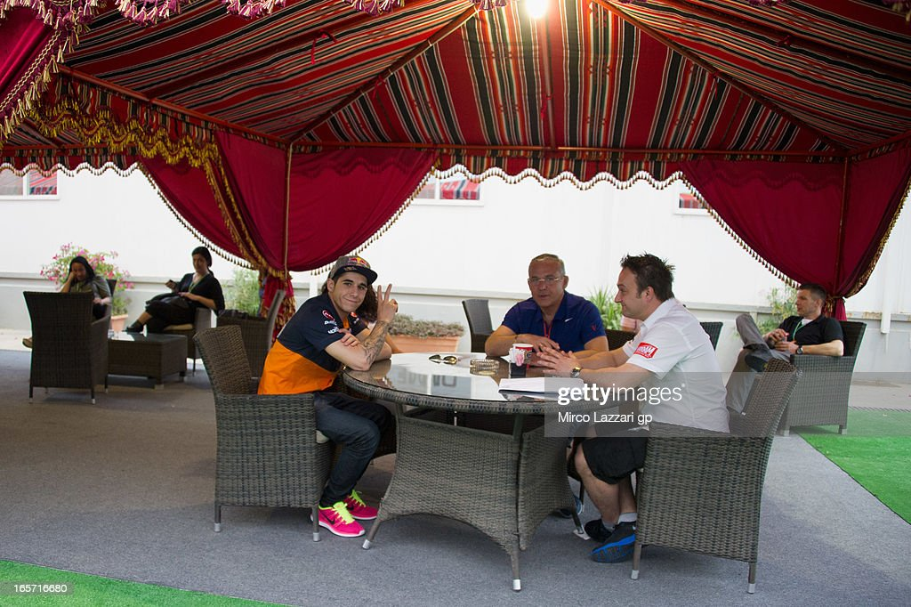 Luis Salom of Spain and RW Racing GP relax in paddock under the tent during the MotoGp of Qatar - Free Practice at Losail Circuit on April 5, 2013 in Doha, Qatar.
