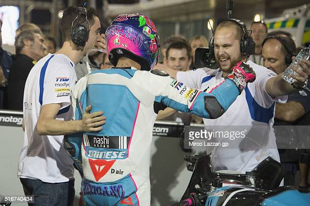 Luis Salom of Spain and SAG Team celebrates with team under the podium at the end of the Moto2 race during the MotoGp of Qatar Race at Losail Circuit...