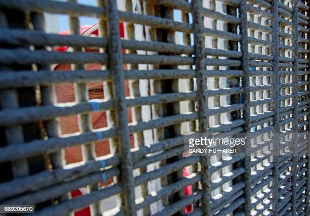 Luis Sanchez looks through the border fence from the Mexico side during an Easter mass along the USMexico border fence at Friendship Park in San...