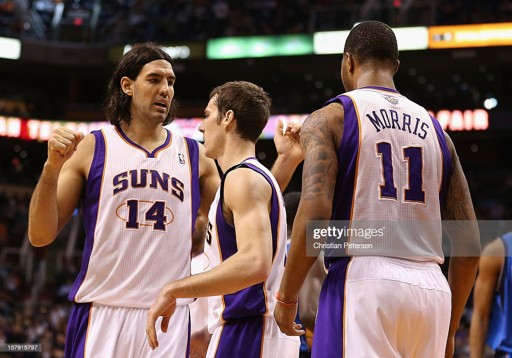 Luis Scola #14 and Goran Dragic #1 of the Phoenix Suns high-five after scoring against the Dallas Mavericks during the NBA game at US Airways Center on December 6, 2012 in Phoenix, Arizona. The Mavericks defeated the Suns 97-94.