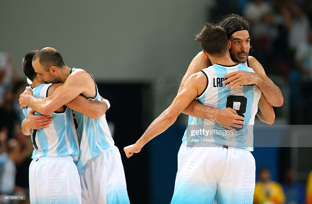 Luis Scola and Nicolas Laprovittola of Argentina celebrate victory after a preliminary round basketball game between Croatia and Argentina on Day 4...