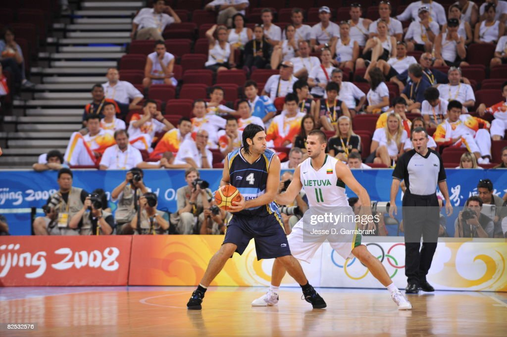 Luis Scola of Argentina loks to drive against Linas Kleiza of Lithuania during the men's bronze medal basketball game at the 2008 Beijing Olympic...
