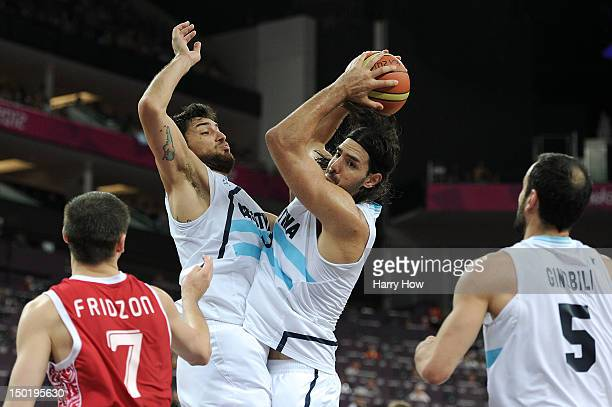 Luis Scola of Argentina runs into team mate Carlos Delfino of Argentina during the Men's Basketball bronze medal game between Russia and Argentina on...