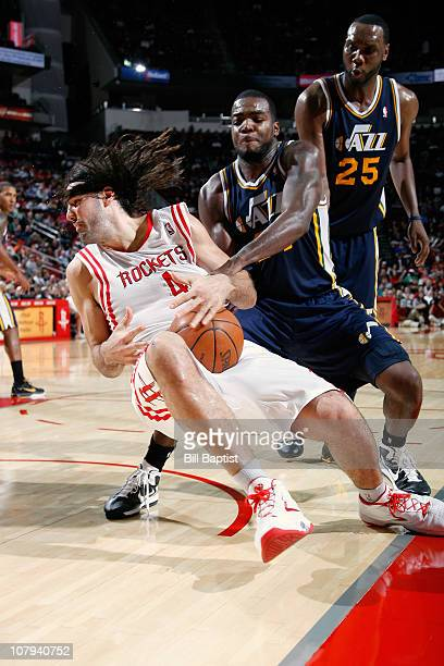 Luis Scola of the Houston Rockets and CJ Miles of the Utah Jazz battle for the ball on January 8 2011 at the Toyota Center in Houston Texas NOTE TO...