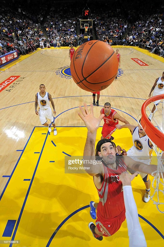 Luis Scola #4 of the Houston Rockets flips up a shot against the Golden State Warriors on December 20, 2010 at Oracle Arena in Oakland, California.