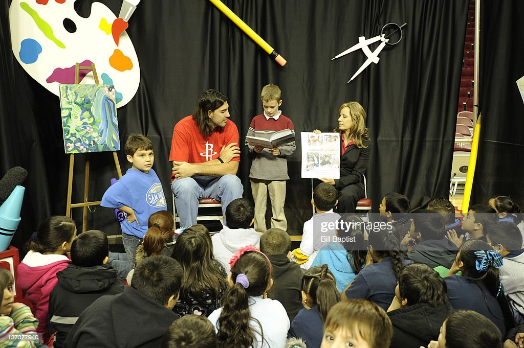 <a gi-track='captionPersonalityLinkClicked' href=/galleries/search?phrase=Luis+Scola&family=editorial&specificpeople=2464749 ng-click='$event.stopPropagation()'>Luis Scola</a> #4 of the Houston Rockets helps a child during Read Play Win on January 18, 2012 at the Toyota Center in Houston, Texas.