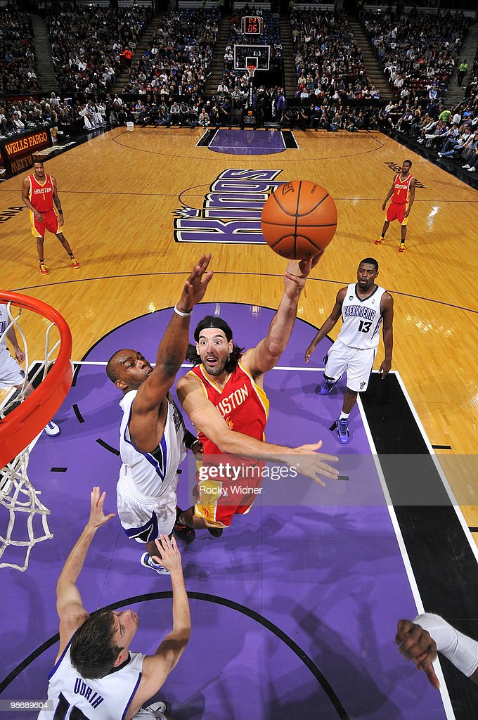 Luis Scola #4 of the Houston Rockets hooks a shot over Carl Landry #24 of the Sacramento Kings at Arco Arena on April 12, 2010 in Sacramento, California. The Rockets won 117-107.