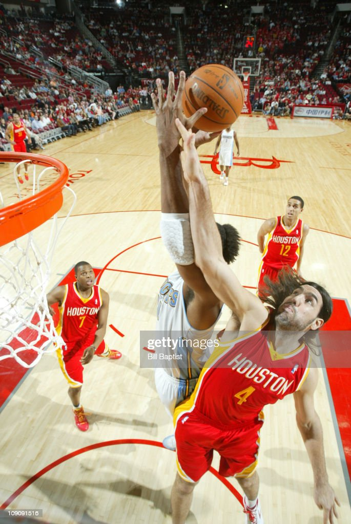Luis Scola #4 of the Houston Rockets rebounds the ball against the Denver Nuggets on February 14, 2011 at the Toyota Center in Houston, Texas.