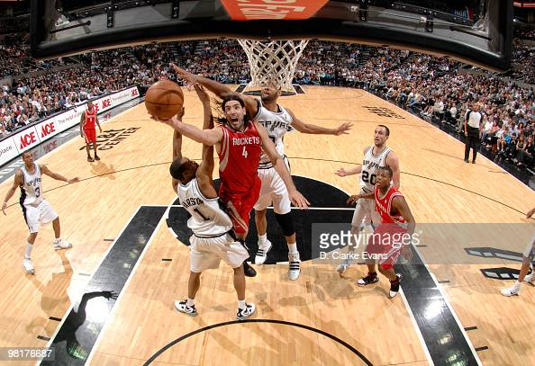 Luis Scola of the Houston Rockets shoots against Tim Duncan and Malik Hairston of the San Antonio Spurs on March 31 2010 at the ATT Center in San...