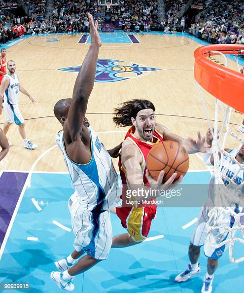 Luis Scola of the Houston Rockets shoots over Emeka Okafor and David West of the New Orleans Hornets on February 21 2010 at the New Orleans Arena in...