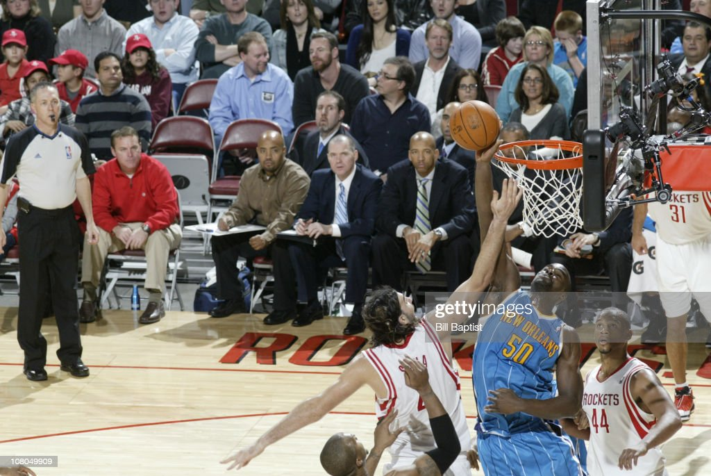 Luis Scola of the Houston Rockets shoots the ball against Emeka Okafor of the New Orleans Hornets on January 14 2011 at the Toyota Center in Houston...
