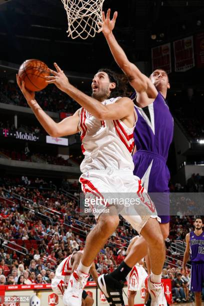 Luis Scola of the Houston Rockets shoots the ball over Beno Udrih of the Sacramento Kings on November 21 2009 at the Toyota Center in Houston Texas...