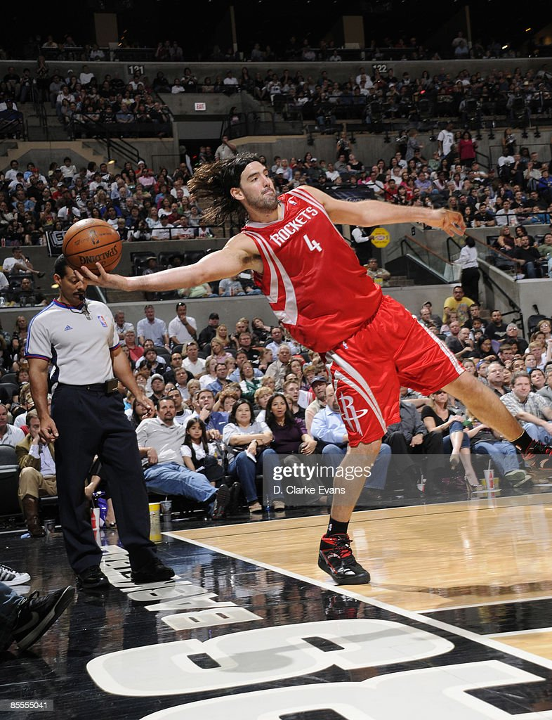 Luis Scola #4 of the Houston Rockets tries to save a ball against the San Antonio Spurs on March 22, 2009 at the AT&T Center in San Antonio, Texas.