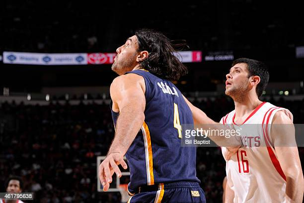 Luis Scola of the Indiana Pacers boxes out Kostas Papanikolaou of the Houston Rockets during the game on January 19 2015 at the Toyota Center in...