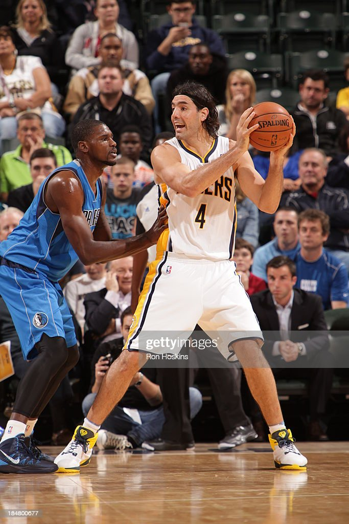 <a gi-track='captionPersonalityLinkClicked' href=/galleries/search?phrase=Luis+Scola&family=editorial&specificpeople=2464749 ng-click='$event.stopPropagation()'>Luis Scola</a> #4 of the Indiana Pacers controls the ball against the Dallas Mavericks at Bankers Life Fieldhouse on October 16, 2013 in Indianapolis, Indiana.