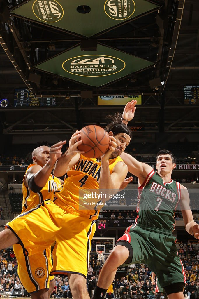 Luis Scola #4 of the Indiana Pacers grabs the rebound against the Milwaukee Bucks on March 12, 2015 at Bankers Life Fieldhouse in Indianapolis, Indiana.