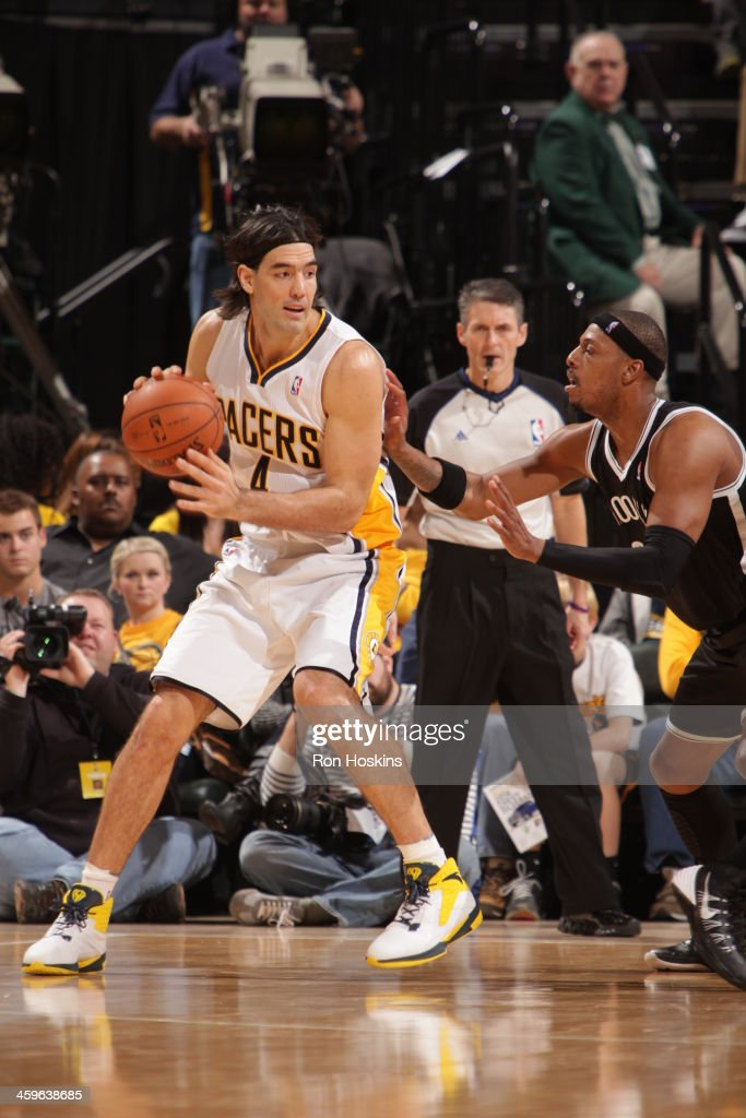 Luis Scola #4 of the Indiana Pacers looks to pass the ball against the Brooklyn Nets at Bankers Life Fieldhouse on December 28, 2013 in Indianapolis, Indiana.