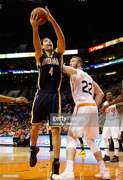 Luis Scola of the Indiana Pacers puts up a shot over Miles Plumlee of the Phoenix Suns during the second half of the NBA game at US Airways Center on...