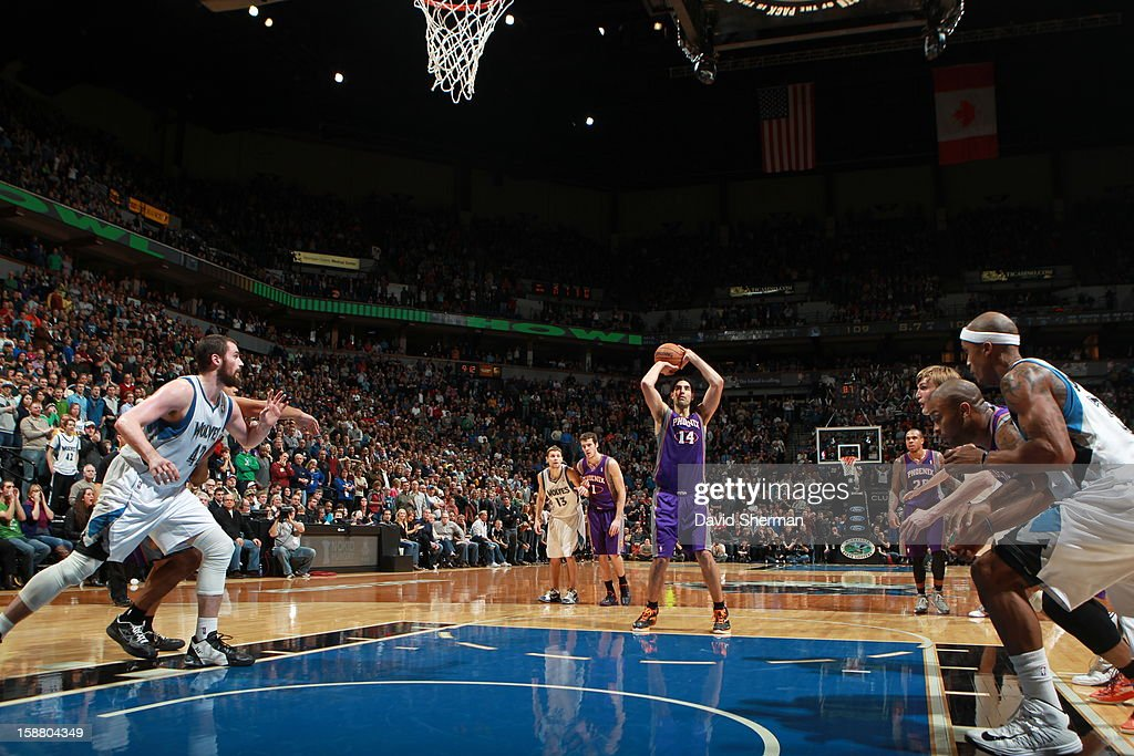<a gi-track='captionPersonalityLinkClicked' href=/galleries/search?phrase=Luis+Scola&family=editorial&specificpeople=2464749 ng-click='$event.stopPropagation()'>Luis Scola</a> #14 of the Phoenix Suns aims during the game between the Minnesota Timberwolves and the Phoenix Suns during the game on December 29, 2012 at Target Center in Minneapolis, Minnesota.