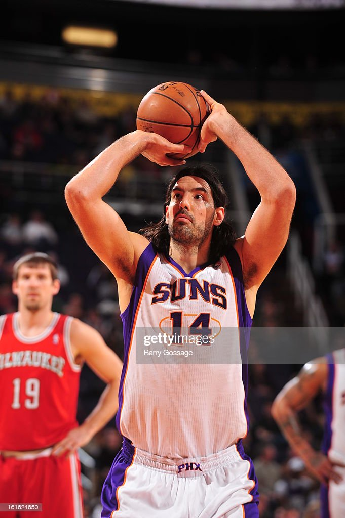 <a gi-track='captionPersonalityLinkClicked' href=/galleries/search?phrase=Luis+Scola&family=editorial&specificpeople=2464749 ng-click='$event.stopPropagation()'>Luis Scola</a> #14 of the Phoenix Suns attempts a foul shot against the Milwaukee Bucks on January 17, 2013 at U.S. Airways Center in Phoenix, Arizona.