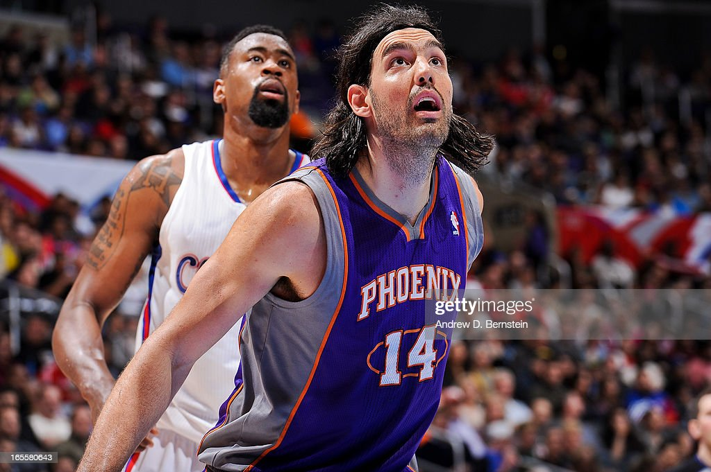 Luis Scola #14 of the Phoenix Suns battles for rebound position against DeAndre Jordan #6 of the Los Angeles Clippers at Staples Center on April 3, 2013 in Los Angeles, California.