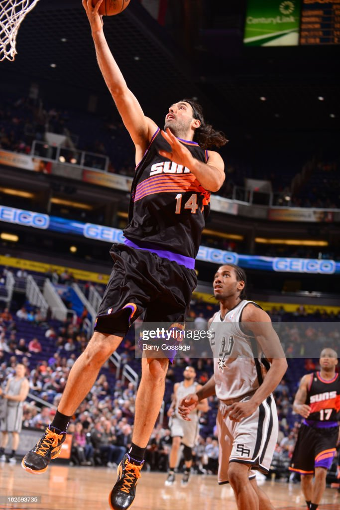 <a gi-track='captionPersonalityLinkClicked' href=/galleries/search?phrase=Luis+Scola&family=editorial&specificpeople=2464749 ng-click='$event.stopPropagation()'>Luis Scola</a> #14 of the Phoenix Suns drive for a layup against the San Antonio Spurs on February 24, 2013 at U.S. Airways Center in Phoenix, Arizona.
