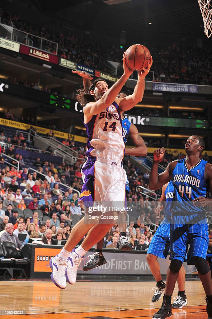 Luis Scola #14 of the Phoenix Suns drives for a shot against the Orlando Magic on December 9, 2012 at U.S. Airways Center in Phoenix, Arizona.
