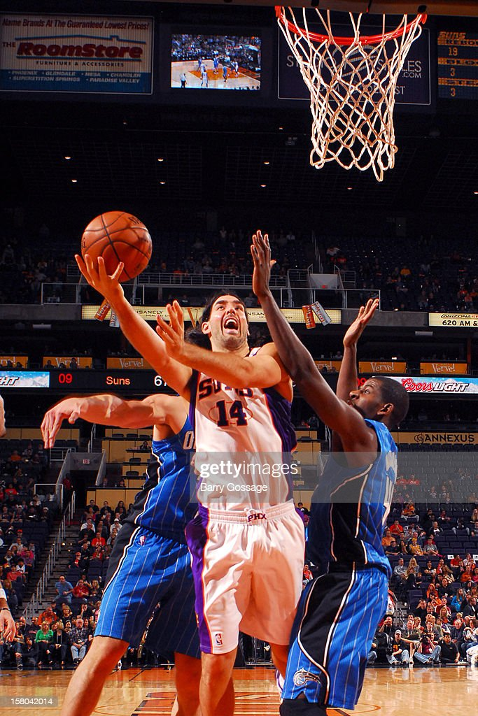 Luis Scola #14 of the Phoenix Suns drives for a shot past Andrew Nicholson #44 of the Orlando Magic on December 9, 2012 at U.S. Airways Center in Phoenix, Arizona.