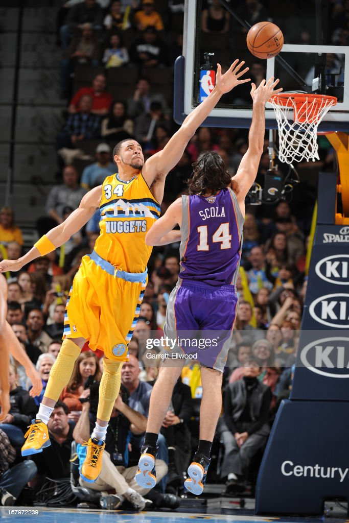 <a gi-track='captionPersonalityLinkClicked' href=/galleries/search?phrase=Luis+Scola&family=editorial&specificpeople=2464749 ng-click='$event.stopPropagation()'>Luis Scola</a> #14 of the Phoenix Suns drives to the basket against <a gi-track='captionPersonalityLinkClicked' href=/galleries/search?phrase=JaVale+McGee&family=editorial&specificpeople=4195625 ng-click='$event.stopPropagation()'>JaVale McGee</a> #34 of the Denver Nuggets on April 17, 2013 at the Pepsi Center in Denver, Colorado.