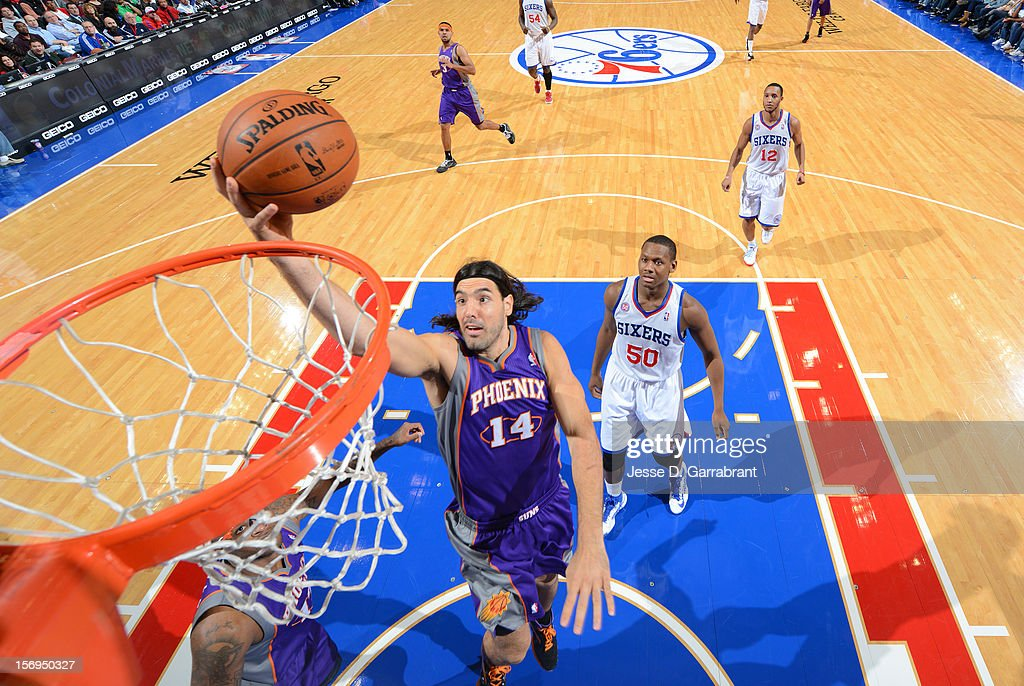 <a gi-track='captionPersonalityLinkClicked' href=/galleries/search?phrase=Luis+Scola&family=editorial&specificpeople=2464749 ng-click='$event.stopPropagation()'>Luis Scola</a> #14 of the Phoenix Suns drives to the basket against the Philadelphia 76ers at the Wells Fargo Center on November 25, 2012 in Philadelphia, Pennsylvania.