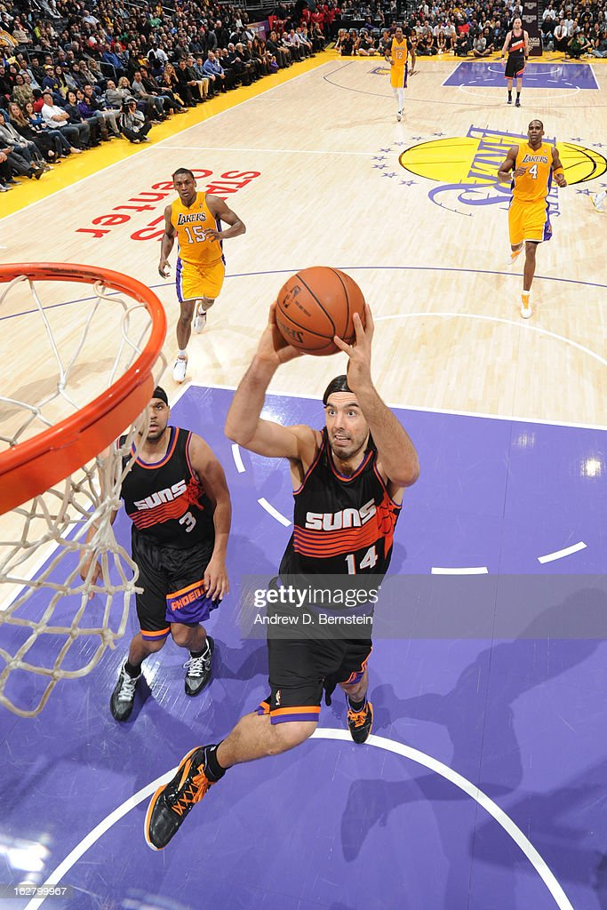 <a gi-track='captionPersonalityLinkClicked' href=/galleries/search?phrase=Luis+Scola&family=editorial&specificpeople=2464749 ng-click='$event.stopPropagation()'>Luis Scola</a> #14 of the Phoenix Suns drives to the basket against the Los Angeles Lakers at Staples Center on February 12, 2013 in Los Angeles, California.