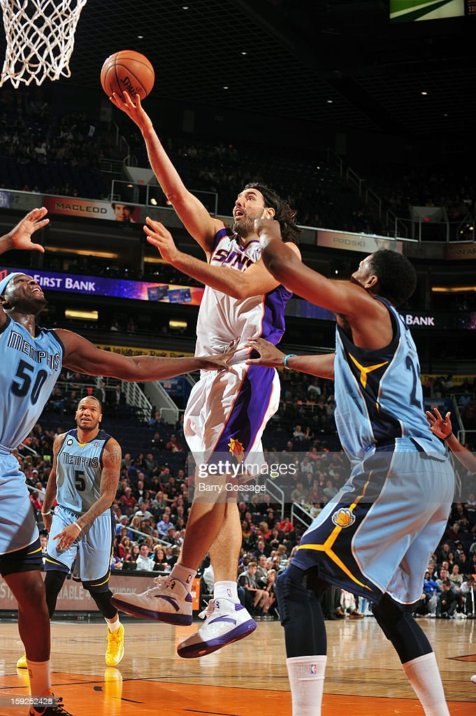 <a gi-track='captionPersonalityLinkClicked' href=/galleries/search?phrase=Luis+Scola&family=editorial&specificpeople=2464749 ng-click='$event.stopPropagation()'>Luis Scola</a> #14 of the Phoenix Suns drives to the basket against the Memphis Grizzlies on January 6, 2013 at U.S. Airways Center in Phoenix, Arizona.
